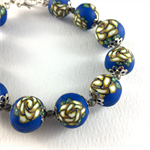 Handcrafted polymer clay bracelet - cobalt blue and cream floral