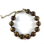 Handcrafted polymer clay bracelet - gold and black snakeskin effect