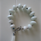 White Glass Bead Bracelet with Tassel feature