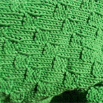 Hand knitted baby rug, for floor, car seat or pram.