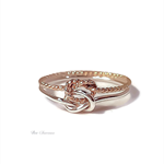 Gold twist and sterling silver double love knot ring