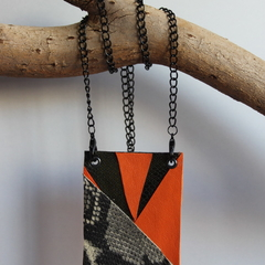Recycled orange and snakeskin leather pendant on black chain
