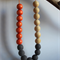 Recycled grey, orange and natural wooden beaded necklace