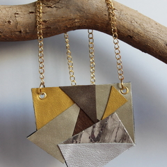 Recycled bronze and metallic leather pendant