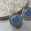 Royal Blue and Green Mandala 16mm Print Glass Earrings hung from silver plated n