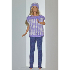 Includes doll and knitted 3 piece outfit. Tunic, leggings, beanie.
