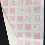 No 62 - Pink and white squared quilt
