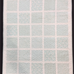 No 83 - Aqua and white squared quilt