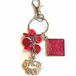 Red Glitter keychain with 'special teacher' charm and buttons