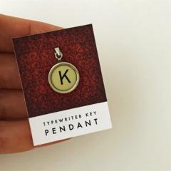 Pendant created from a vintage typewriter key - letter K, creamy ivory key