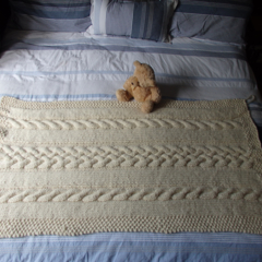 Hand knitted cable throw or bed runner