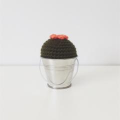Mini crochet cactus with orange flower in metal bucket