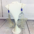 Earrings, sterling silver with silver leaves and vivid blue beads.