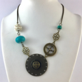 Bronze Disk Necklace with Turquoise and White Howlite beads on Bronze Hardware
