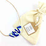 Handcrafted polymer clay statement pendant on leather cord- white, yellow, blue