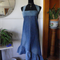 Halterneck dress with asymmetrical ruffled hem