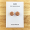 Handcrafted polymer clay stud earrings in copper and copper leaf