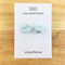 Handcrafted polymer clay stud earrings in blue and white waves
