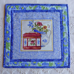 Set of 2 mats (table or trivet)  Blue with tea cup design
