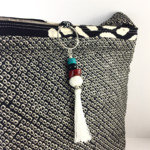 Handcrafted kimono fabric handbag with beaded tassel- peach black white shibori
