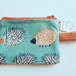 Zippered coin pouch/purse in blue hedgehog and orange corduroy fabric