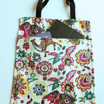 Tote bag in a floral purple and teal cotton