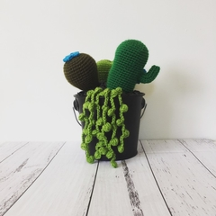 Crochet cacti and succulents arrangement in metal bucket