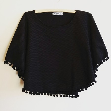 Black shawl with pompoms