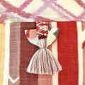 Handcrafted kimono fabric handbag with polymer clay embellishment