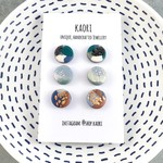 Three pairs of handcrafted polymer clay stud earrings in metallic variations