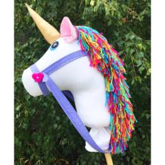 White unicorn hobby horse with rainbow mane