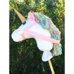 White unicorn hobby horse with pastel rainbow mane