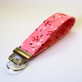 Wrist Key Fob / Keyring - Music Notes, Red Ribbon Bows on Pink