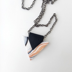 Two sided white, black and copper geometric polymer clay pendant