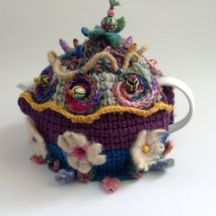 One of a kind embellished 4-6 cup tea cosy. Floral theme.