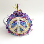 Embellished crochet hippie peace tea cosy. 4-6 cup.