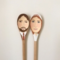 Two wooden spoon portraits.