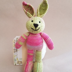Tiddler Bunny in bright pink and green.