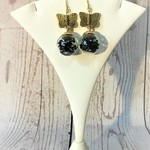 Earrings, gold with glass bottle, black flowers and gold butterflies.