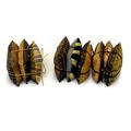 Trio of cedar sachets in mustard silks.
