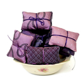 Trio of cedar sachets in purple tones. Reclaimed silk fabrics from vintage ties