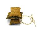 Trio of cedar sachets in mustard tones. Reclaimed silk fabrics from mens ties