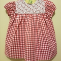 Classic red gingham dress with vintage daisy lace overlay bodice. Size 000-6mths