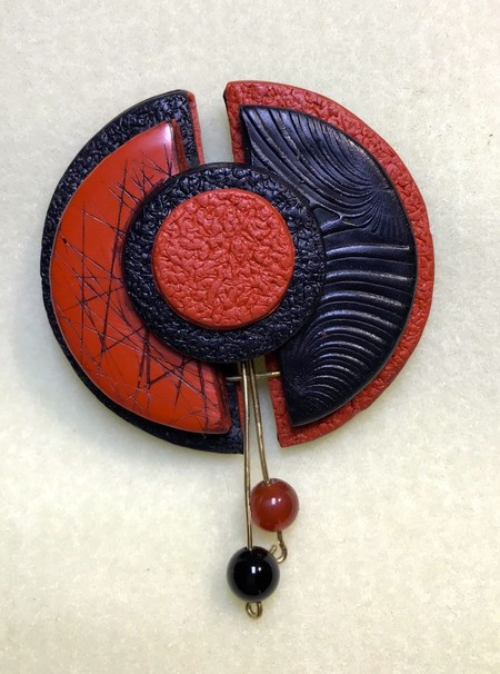 Brooch black and red