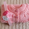 Size 6-12 mths hand knitted beanie in Coral Pink : washable, practical,