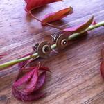 Circular metal watch part earrings; clockwork jewellery.