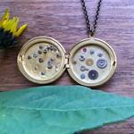 SALE! Intricate gold watch part locket.