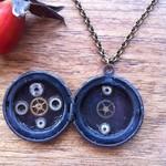 Bronze and black interesting clockwork locket.