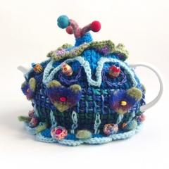 Unique embellished 4-6 cup tea cosy.