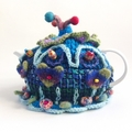 Unique embellished 4-6 cup tea cosy.